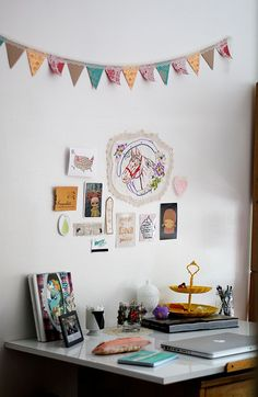 Office space in a dorm room with cute bunting and even cuter wall art!
