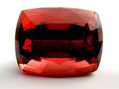 This 20.42 ct tourmaline exhibits a beautiful cinnamon or orange-brown color. Although the exact locality is unknown, it is from East Africa.