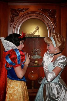 Snow White and Cinderella. I think this is in the hallway at the top of the stairs before entering the dining room in Cinderella's castle.