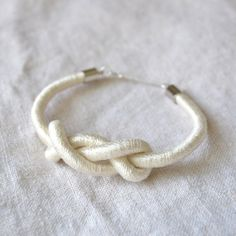 slightly different infinity knot  #handmade #jewelry #bracelet #knotting