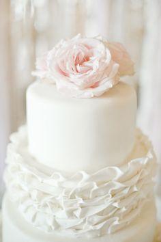 Ruffled wedding cake: http://www.stylemepretty.com/2014/09/25/blush-pink-chic-downtown-memphis-wedding-at-409-south-main/ | Photography: Ashley Upchurch - http://ashleyupchurchphotography.com/