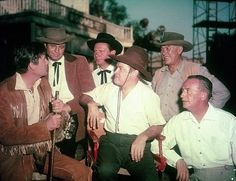 "ALIAS JESSE JAMES (1959) - Paramount backlot - From l. to r. - Fess Parker as ""Davy Crockett"" - Jim Davis as ""Frank James"" - Wendell Corey as ""Jesse James"" - Bob Hope (seated) - Ward Bond as 'Major Seth Adams' of ""Wagon Train"" - director Norman Z. McLeod - United Artists."