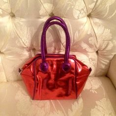 🆕Purple💜&Red❤️ Metallic Purse by Giannini Bini👛 Genuine Faux Metallic Red and Purple Leather👛By Giannini Bini❣6in high x 9in wide❣can add a chain shoulder strap❣or carry as a clutch👛Bundle🚫Trades🚫Offer button is preferred via all offers❣New Never used💋Thank You👛 Gianni Bini Bags Clutches & Wristlets