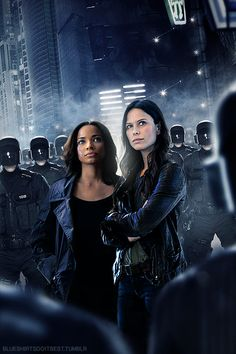 "Blueshirts Do It Best, ""Almost Human"" Female Genderbend Rhona Mitra as John Kennex, Rochelle Aytes as Dorian. FOX Almost Human TV Show -"