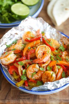 Shrimp Fajitas in Foil — all the flavors of shrimp fajitas with far less cleanup since they're baked in a foil pouch, via @damndelicious