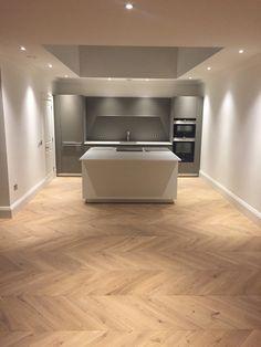 Oak Natural. Chevron Parquet Engineered Wood Floor.   Luxury apartments in Edinburgh - Chevron parquet supplied and installed.