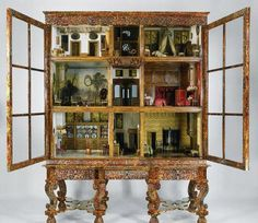 This dollhouse in a china cabinet.