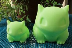 Enjoy a combo set of 2 Bulbasaur Planters:  A very big size Bulbasaur Planter (5.5x5.5x5.5 inches) and a medium/small size Bulbasaur Planter (3x3x3 inches). The inside of the pot of the large one measures 3 (8 cm) in diameter, and the small ones is just under 2 (5 cm) in diameter. They both have a small drainage hole in the bottom.  They are both 3d printed in a nice green color that matches the original, and really showcases your plants! They are printed with PLA plastic which is…