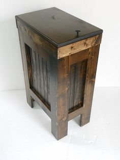 A wooden garbage can, who would have thought something like that is even possible. Well obviously someone did because here is a gorgeous example of a wooden trash bin for your kitchen.