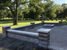 South Lyon Michigan-Unilock-Brussels Block retaining wall fire pit and pillars with Beacon hill brick pavers. Designed and Installed by All Natural Landscapes of Hartland Mich Brick Paver Patio, Concrete Paving, Retaining Wall Blocks, Retaining Walls, Unilock Pavers, Landscape Pavers, Wall Fires, Backyard Seating, Wall Seating