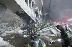 Firefighters look for survivors in the rubble of the World Trade Center. (Photo by Todd Maisel/NY Daily News Archive via Getty Images)