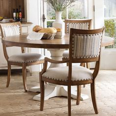 Gather friends and family around this country-chic dining table, showcasing a 2-tone finish and pedestal base. Product: Dining ...