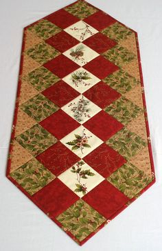 Christmas Table Runner / Quilted Winter Table Topper (#477886021) Holly leaves and berries, pine cones and sprigs on cream together with scarlet red and bark, make this table runner a beautiful addition to your Christmas / winter decoration. It will look wonderful on your kitchen
