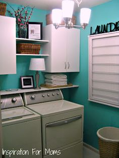 My laundry room is so small. Maybe I need to fix it up like this one. Paint color is not really me, but I love the room's look.