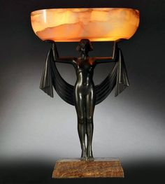 An Art Deco patinated bronze and onyx lamp by Fanny Rozet, France circa 1920s.