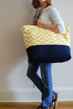 Large beach beach bag with yellow chevron stripes.