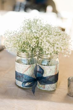 Map & Baby's Breath Centerpieces With Navy Ribbon | Photo: Shelley Marie