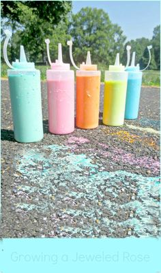 Sidewalk SQUIRT painting with liquid chalk- a super fun way to play and create art in the warm weather! (BONUS- Squirt vinegar on the liquid chalk to make it FIZZ!)
