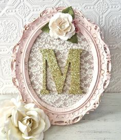 Girl Baby Shower Decorations Girl Shabby Chic Framed Letters Baby Girl Gift  Please allow up to 3 weeks production time  Oval Ornate picture frame painted Antique Pink and distressed for that shabby chic look Gold undertones measures 8x10 inches (inside) *Wooden letters Measure 5 inches tall and come in a block style font Letters are painted in metallic paint and covered in sparkly silver or gold glitter Handcrafted fabric flowers in cream & mauve Cream colored lace fabric background Wall…