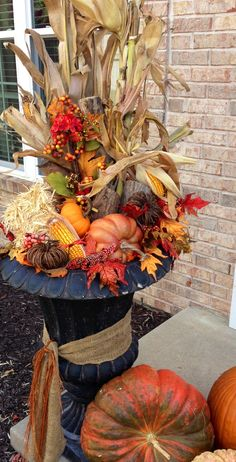 Fall arrangement - I use the artificial outdoor Christmas tree stands for my base. This way they are already in place for me to switch out the Autumn decor for Christmas at the end of November. Easy peasy transition!