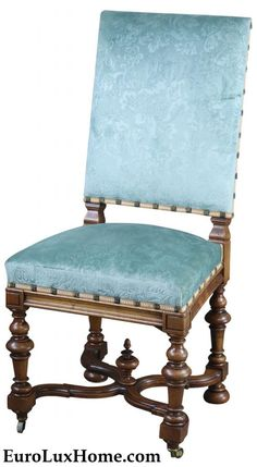 Antique French Louis XIII chair. This is just one of a set of six chairs, and you can see the blue damask upholstery is a great way to add a dash of elegant color to a dining room.The armless chairs are crafted with a walnut wood frame and they date to 1900.  They feature gently curved stretchers forming an X shape, accented by a majestic finial in the center of the X.  The strong shape is softened by the gentle blue upholstery.  #homedecor #antiques #furniture #diningchair #chair #LouisXII French Dining Chairs, Antique Dining Tables, Antique Chairs, Dining Room Chairs, Traditional Dining Room Furniture, Louis Xii, Reproduction Furniture, Armless Chair, Southern Homes