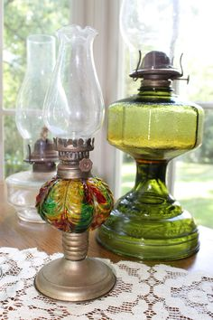 #Prepper - We have oil lamps with colored glass and clear, nice addition to table centerpieces, I saw on your board with the black lanterns in center, oil lamps give same look