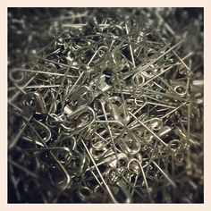 An attempt at taking an artsy picture of a big ole pile of safety pins. bored at work) - Artsy Picture, Bored At Work, Safety Pins, Everyday Objects, How To Dry Basil, Dandelion, Earth, Cool Stuff, Sewing