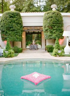 An inspiring gallery of floating decorations for a gorgeous pool wedding reception.