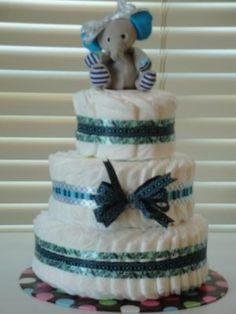 This adorable diaper cake was sent in by Martha from Fredericksburg, Texas. Here is what she said in her own words:  I used the basic spiral instructions