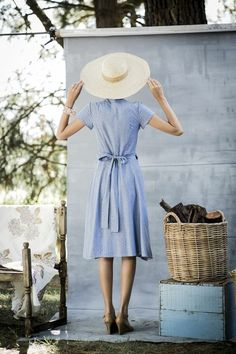 Simple blue sundress and a summer hat