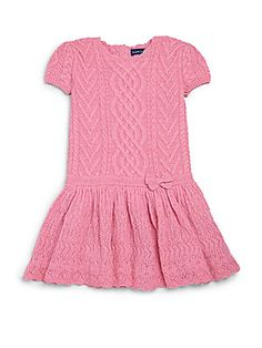 Ralph Lauren Toddler and Little Girl's cashmere sweatedress $285 This luxurious cashmere sweaterdress is crafted in a classic cable-knit design with a sweet ruffled hem. Roundneck Short sleeves Ribbed cuffs Back button placket Drop waist Ruffled hem Lining: silk/elastane Cashmere Dry clean Imported