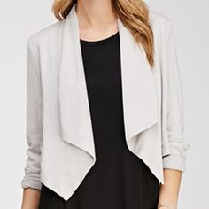 Host Pick 2/20  Gray Cropped Blazer Forever 21 F21 Contemporary - This open-front woven blazer is cropped perfectly for pairing with sleek body-conscious dresses and high waisted tailored trousers. The lightly padded shoulders and angled sides add structure to this drapey piece. Never worn. Forever 21 Jackets & Coats Blazers