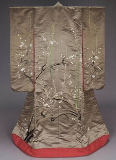 """Uchikake (wedding over-kimono), Meiji period, 19th century, Japan.  """"    Long-sleeved brown silk satin outer robe (uchikake) with padded hem and large-scale design of a blossoming plum tree in light and dark brown, white and green silk embroidery with three small crests with backside of chrysanthemum (uragiku) in gold along the top at the neck and sleeves; reddish-orange silk crepe lining with """"waistband,""""      MFA. (William Sturgis Bigelow Collection)"""