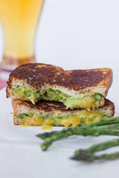 Roasted Asparagus Grilled Cheese with Artichoke Arugula Pesto. Fresh and perfect for spring! #vegetarian #sandwiches