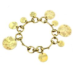 Gucci 'Flora St. Tropez' 18k Gold Medallion Bracelet.  I've been obsessed with this line since it's debut in 2007.  The Flora design was originally designed for Princess Grace of Monaco in 1966