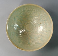 Chinese celadon bowl, possibly Song, incised to the interior with birds and flowers, 16.8cm