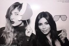 Yes, she WAS there: Kim posed with pal Brittny Gastineau at Kris Jenner's Christmas Eve ba...