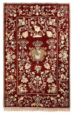 Tapestry.Sicily, early 19th century.Extremely fine embroidery on velvet. Floral scrolls and leaf motifs in many colors around a central cartouche with the crowned coat of arms of Baron de la Torre, Messina, around 1798 - 1807.