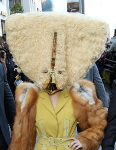 Believe it or not, there's a fame monster under there. Lady Gagacovers up in chilly Berlin on Oct. 24