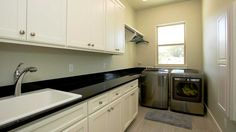 Like this laundry room - cabinet space, sink and place to hang clothes.