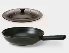 Pretty sure I just found my dream cookware (if only I could afford it)...LONGABERGER Flameware!!! Freezer, oven, stove, microwave, grill, and dishwasher safe!  It is made from 100 percent natural materials — nothing artificial, no alloy metals or synthetic bonding agents. Unlike other traditional cookware, it is non-reactive, which means it will not release fumes or cause 'leaching' of harmful metals into your food. Retains heat so you can you a lower heat setting. SOUNDS AMAZING!!