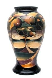 A Moorcroft pottery vase by Sian Leeper, c.2006, tube line decorated with stylised Art Nouveau style trees against a landscape backdrop, on a baluster body, impressed and painted marks, 42cm high.