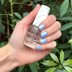 Glossy nails are for Fridays.  We tried the @opi_products Plumping Volumizing top coatit gives an effect like gel nailsand boy did it deliver. #glossynails #shinynails #bluenails hand model: @keyboardcat1