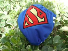 One Size Superman Inspired Cloth Pocket Diaper.  She'll also make covers or all-in-2s on request.  $22