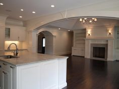 Fireplace idea. Columns in archway.