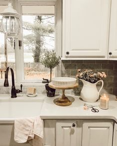 To get the French farmhouse look, we added a large sink, marble tile and vintage accents. Wooden cake stand can be purchased at French Country Kitchens, French Country House, French Farmhouse, French Country Decorating, Modern Farmhouse, Farmhouse Style, French Cottage, Farmhouse Decor, Cottage Farmhouse