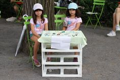 Entrepreneurial twin sisters set up a handmade jewelry stand at Union Square. They look cute now, but wait until it's time to split the money and one of them decides she did the most work.