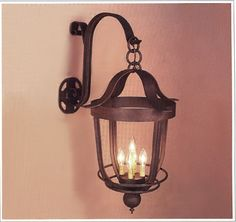 "8066  FIVE LIGHT IRON WALL LAMP FINISH SHOWN: NATURAL RUST SHADE: 35X18X25 WITH ANTIQUE PAPER CANDLE MAXIMUM WATTAGE: 300 CANDELABRA BASE SOCKETS HT 35"" W 18"" PROJ 25"" NOTE: FIXTURE CAN BE MODIFIED TO INCLUDE GLASS CYLINDER FOR EXTERIOR USE"