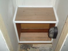Shoe cubbie with trim in my ongoing closet project.
