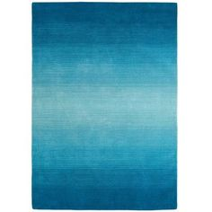 Peacock Ombre Rug - 5x8 at Pier 1 Imports $249.00 item # 24991108 Strut your decorative stuff with this gorgeous hand-woven wool rug. Varying shades of peacock blue contrast beautifully with neutral upholstered furnishings. But you already knew that, right?